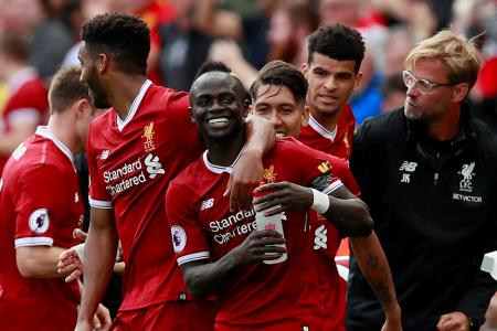 Liverpool's Sadio Mane (C) celebrates scoring their first goal with Liverpool manager Juergen Klopp and team mates
