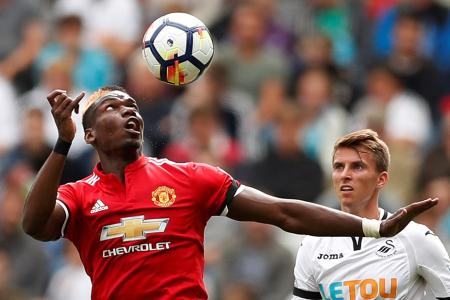 Manchester United's Paul Pogba in action with Swansea City's Tom Carroll
