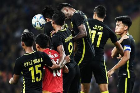 Organisers slam 'Singapore dogs' football chant