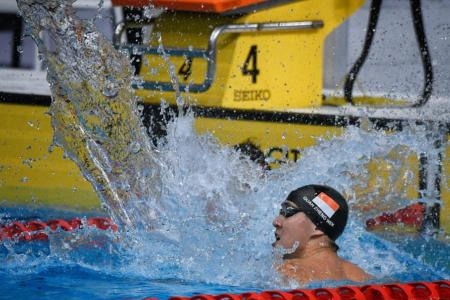 Zheng Wen in rare show of emotion after 100m back win