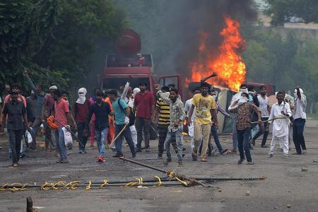 'Godman' convicted of rape, 13 killed in ensuing protests