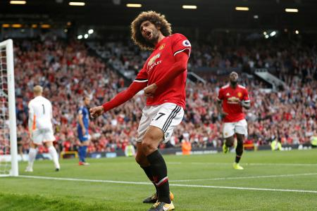 Manchester United's Marouane Fellaini celebrates scoring their second goal