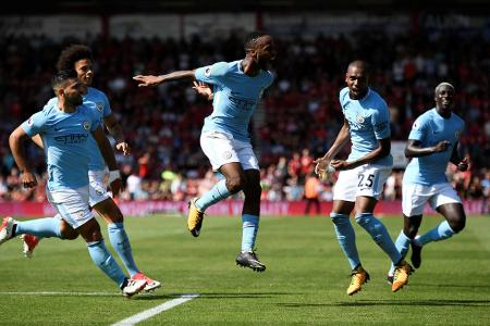 Manchester City's Raheem Sterling celebrates scoring their second goal