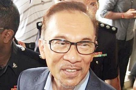 Anwar accused of hiding actual forex losses by Malaysia's central bank