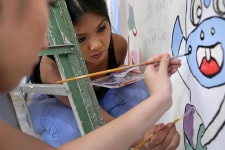 Miss Universe Singapore finalists brightens up children's home with mural