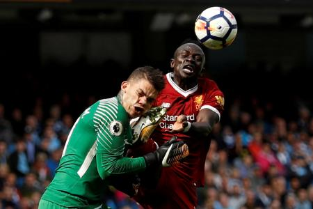 Manchester City's Ederson Moraes is fouled by Liverpool's Sadio Mane resulting in a red card