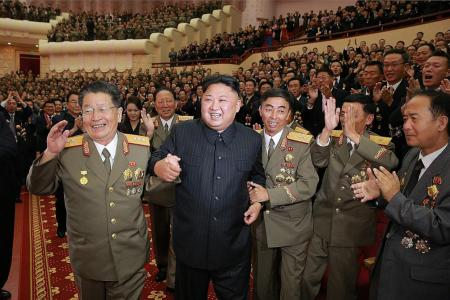 Kim Jong Un hosts party for nuclear experts