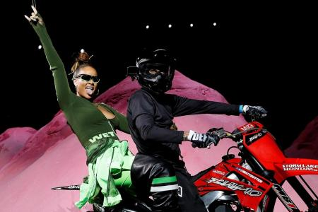 Rihanna rides into NY Fashion Week
