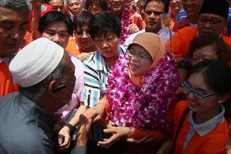 Cheers as Halimah arrives at PA headquarters