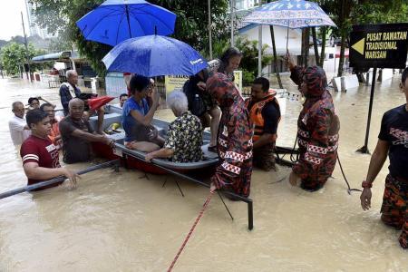 Heavy rains trigger Penang floods