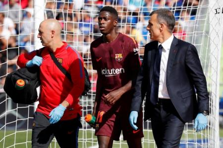 Barcelona's Dembele out 