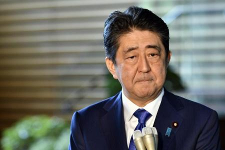 Japan's Abe considering snap polls next month