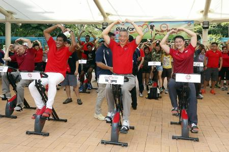 PM Lee, residents pedal hard to donate brown rice to charities