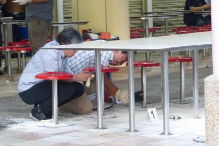 Man arrested over flaming object at food centre