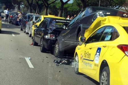 Seven taken to hospital after 12-car pile-up on KPE