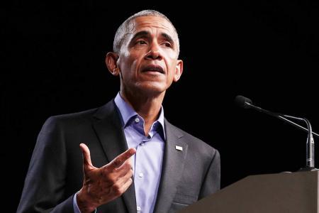 Obama, Bush speak out against deep divisions
