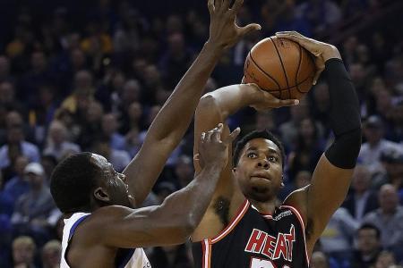Durant, Green help Warriors beat the Heat