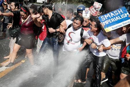 Protesters hosed down by riot police