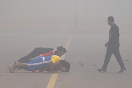 Parents fume as schools reopen despite smog