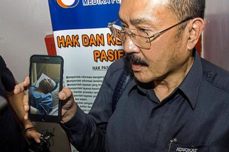 Embattled Indonesian Speaker put under armed guard in hospital