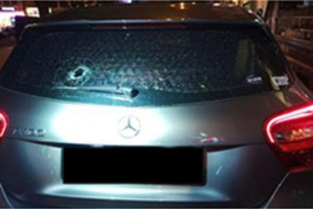 Cabby arrested for throwing pebbles at cars