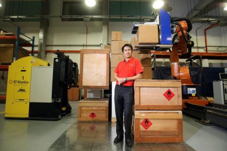 Two robots help with air cargo workers' load
