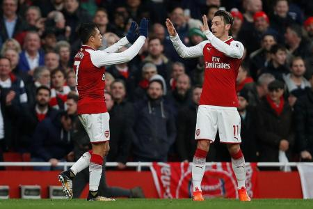 Neville reacts to Lacazette's display in Arsenal's 5-0 win over Huddersfield