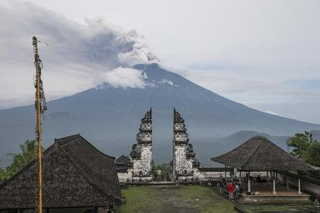 Bali airport reopens after winds clear ash
