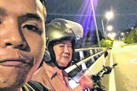 Biker helped elderly man walking along the PIE