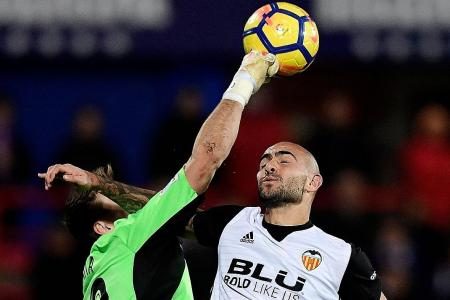 Valencia captain Dani Parejo blames pitch for shock loss