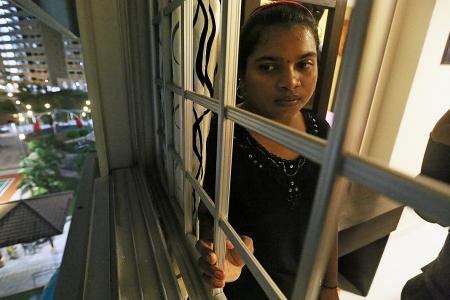 Dangling maid rescued from 5th-storey ledge