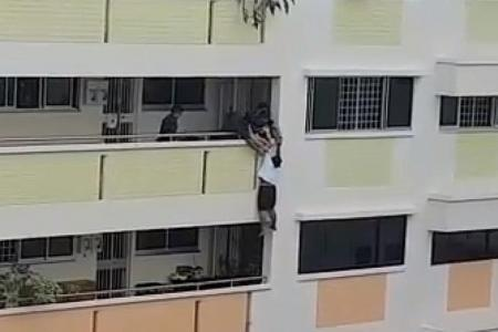 Maid rescued from ledge