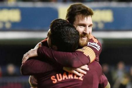 Suarez, Messi on target as Barca go five points clear