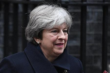 After defeat at home, May to ask EU to move on with Brexit talks