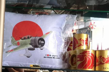 Cushion with Japanese bomber in WWII scene raises eyebrows