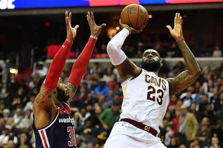 James triple-double fuels Cavs to win; Warriors beat Mavericks