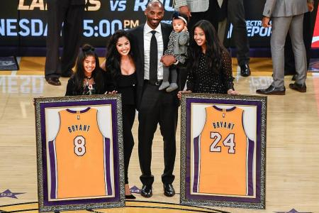 Kobe Bryant hailed the 'greatest' by Magic Johnson
