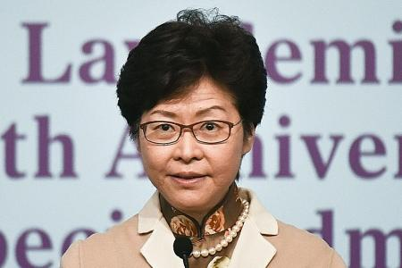 Hong Kong leader says she won't blindly obey Beijing's orders