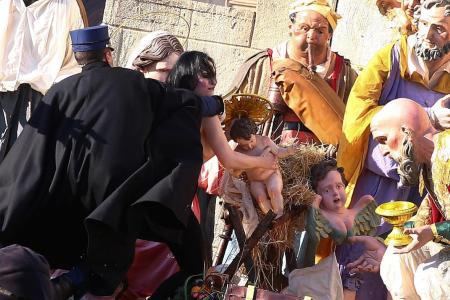 Feminist activist tries to snatch statue from Vatican Nativity scene