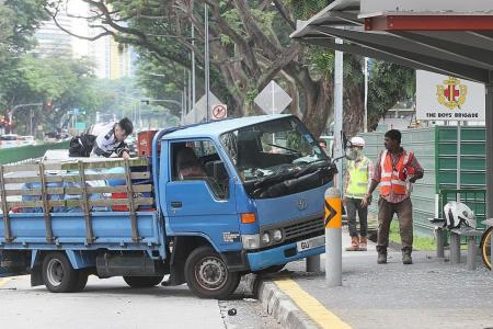 Lorry crashes into bus stop