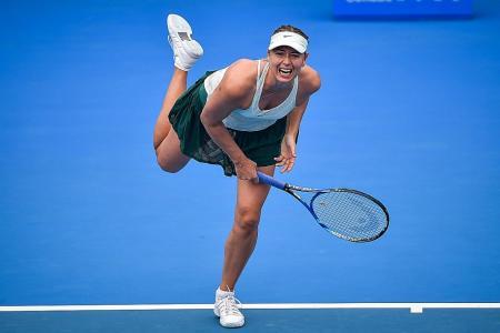 Sharapova rallies to reach last 8 in Shenzhen