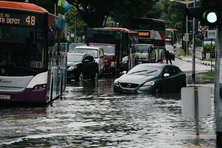 SCDF officers to the rescue as flood waters rise