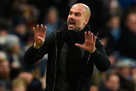 Aguero at the double as Man City keep quadruple bid alive
