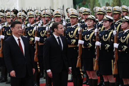 Macron urges China, EU to avoid pitfalls of protectionism