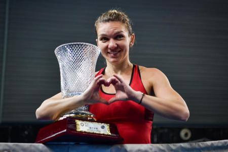 Halep hopes no-brand dress can bring her luck