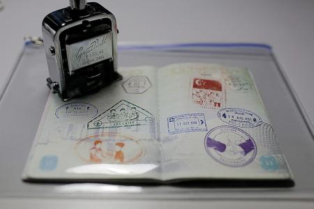 Singapore passport inspires animation on Total Defence
