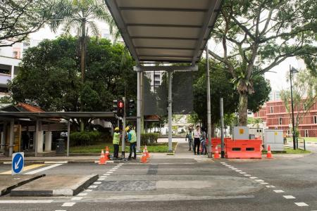 Unaligned sheltered linkway in Jurong West set right