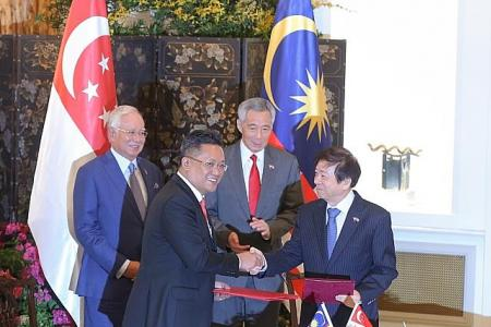 Singapore, Malaysia ink deal for Rapid Transit System