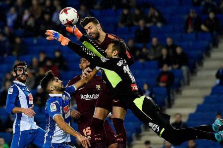 Local rivals Espanyol hand Barca first loss