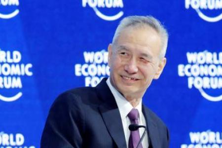 China's economic mastermind pledges more reform at Davos